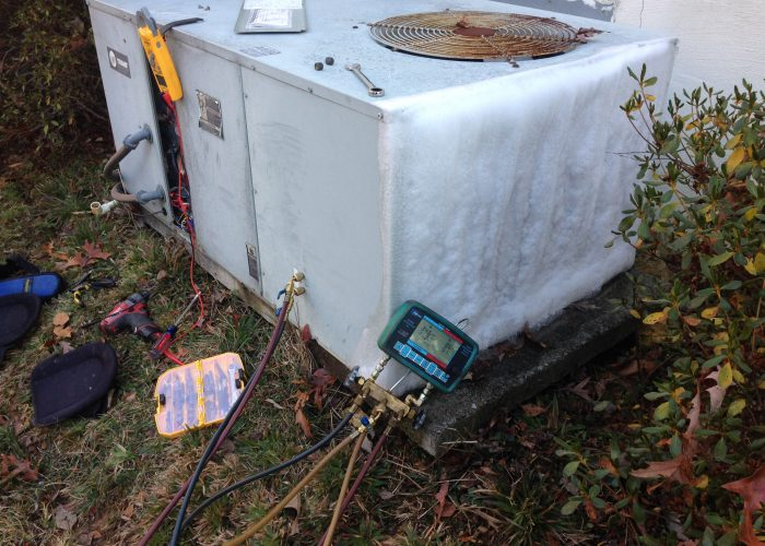 A stuck open defrost thermostat stopped the defrost cylce from occuring.